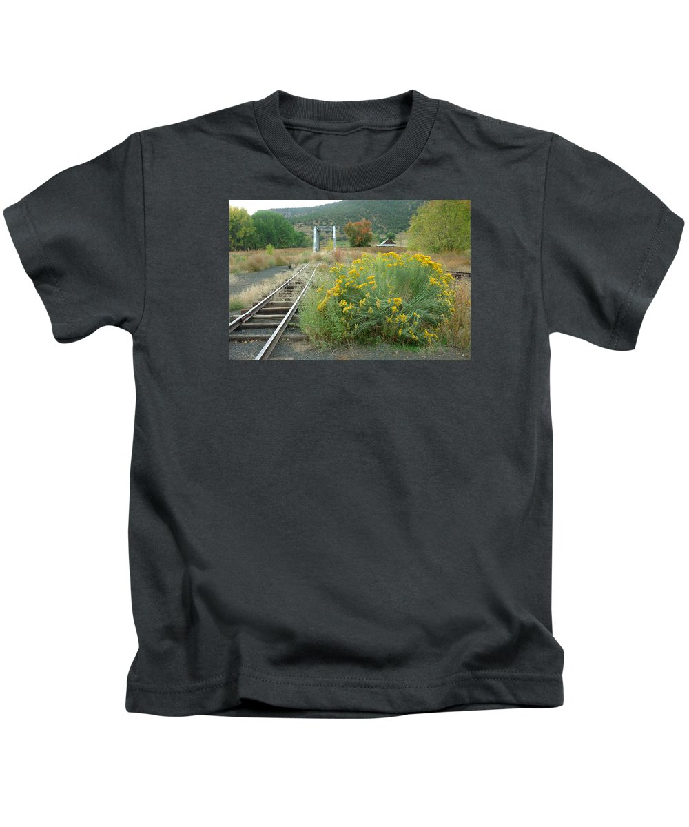Train Kids T-Shirt featuring the photograph The Tracks At Pagosa Junction by Jerry McElroy
