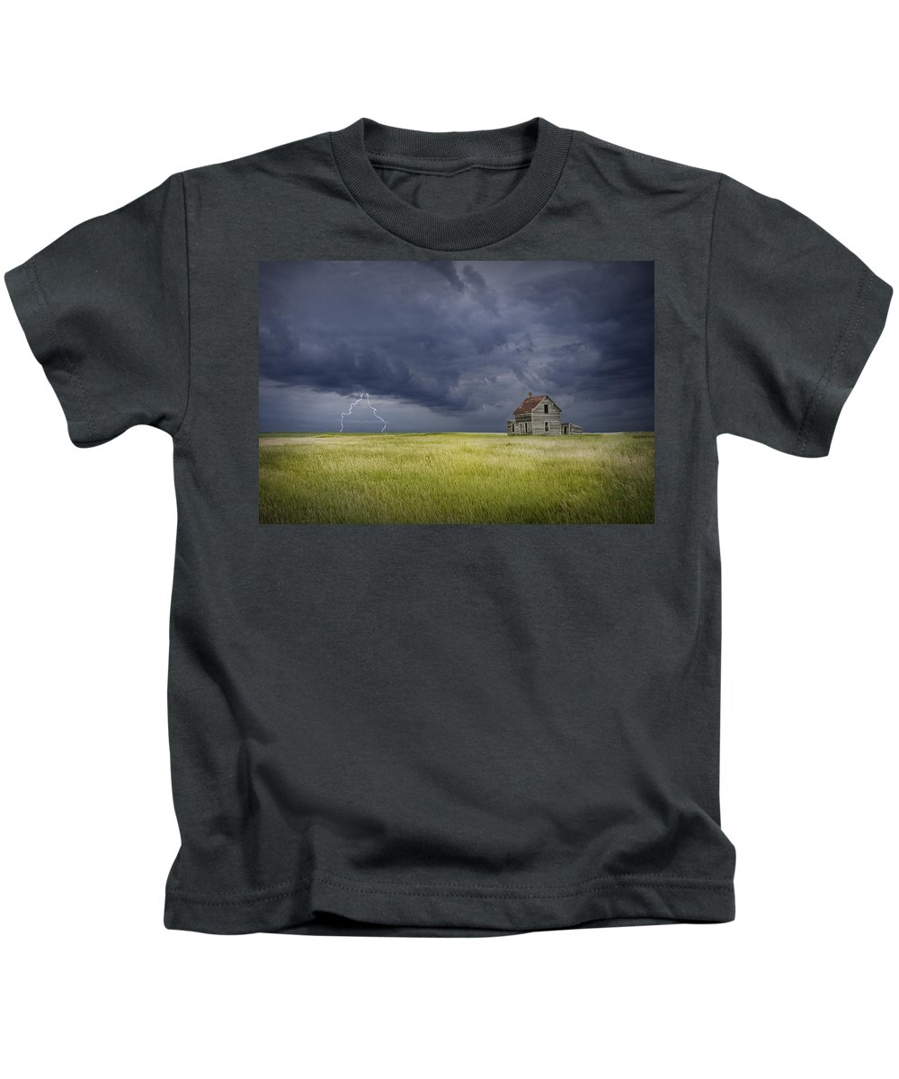 Art Kids T-Shirt featuring the photograph Thunderstorm On The Prairie by Randall Nyhof