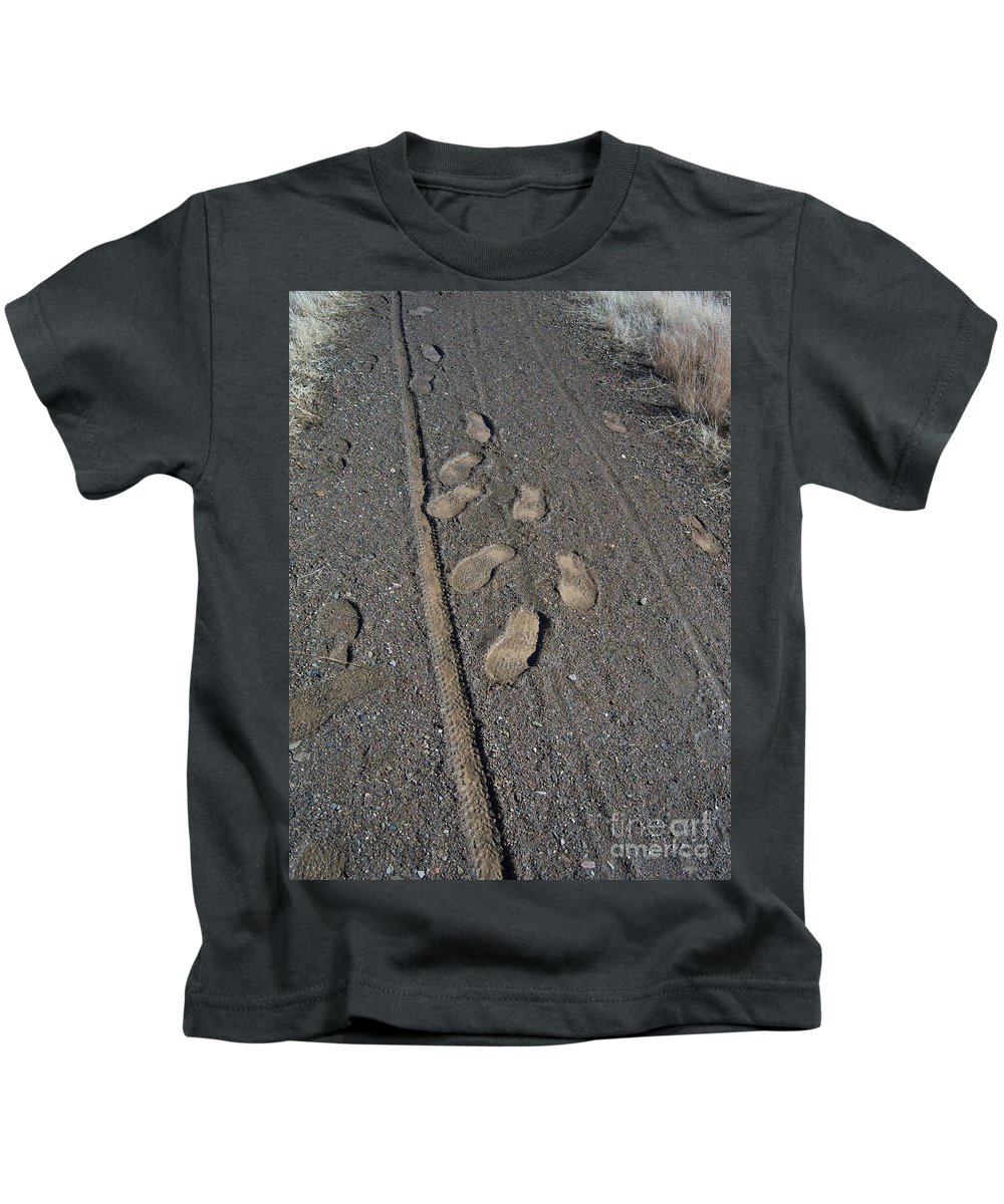 Prescott Kids T-Shirt featuring the photograph Tire Tracks And Foot Prints by Heather Kirk