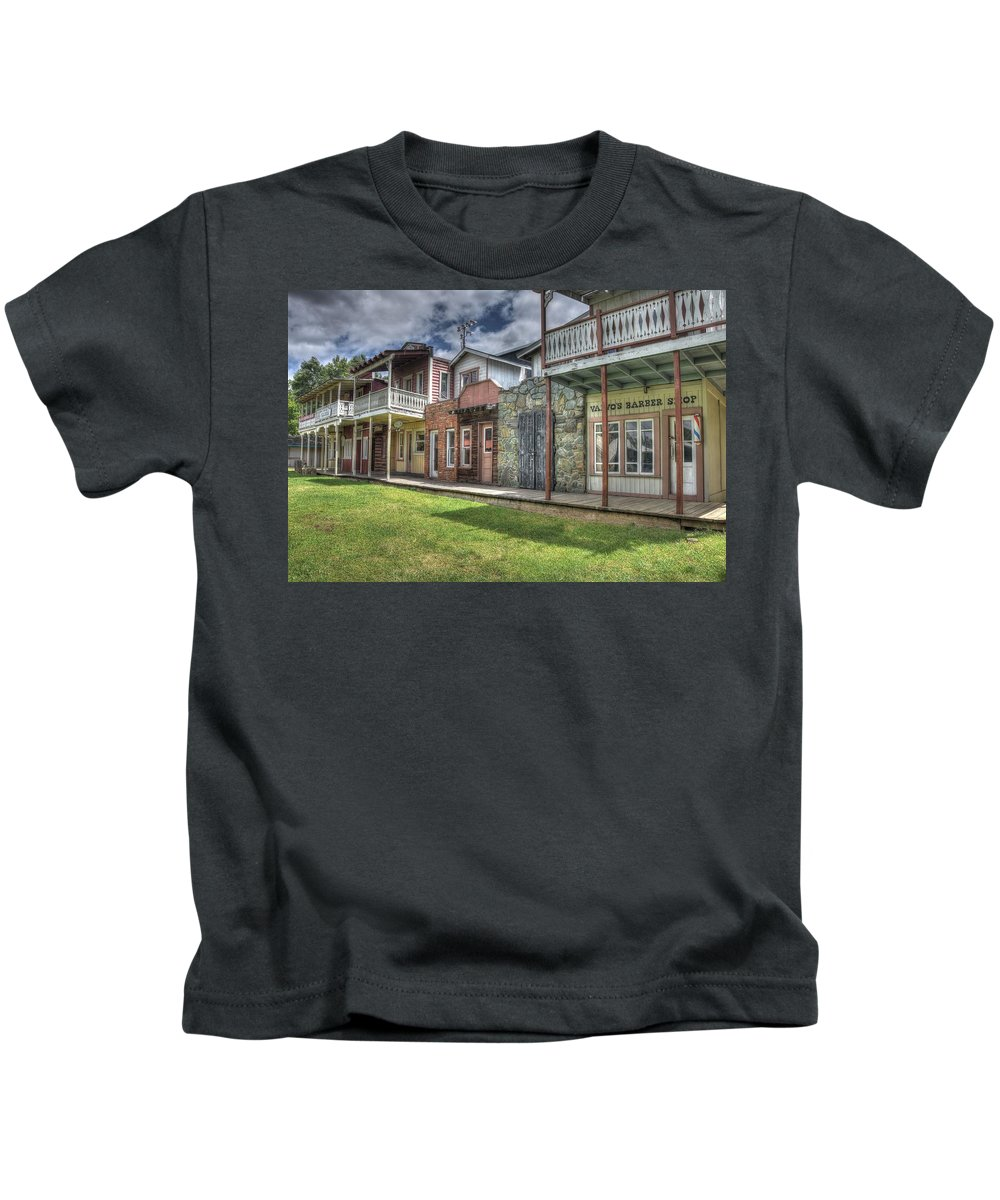 Plymouth Structure Old Town History Rodeo Grounds Wood Mountains Grass Rock Walls Color Red Green Blue Sky Clouds Trees Nature Hdr Kids T-Shirt featuring the photograph Town Of The Fromtier by Thomas Todd