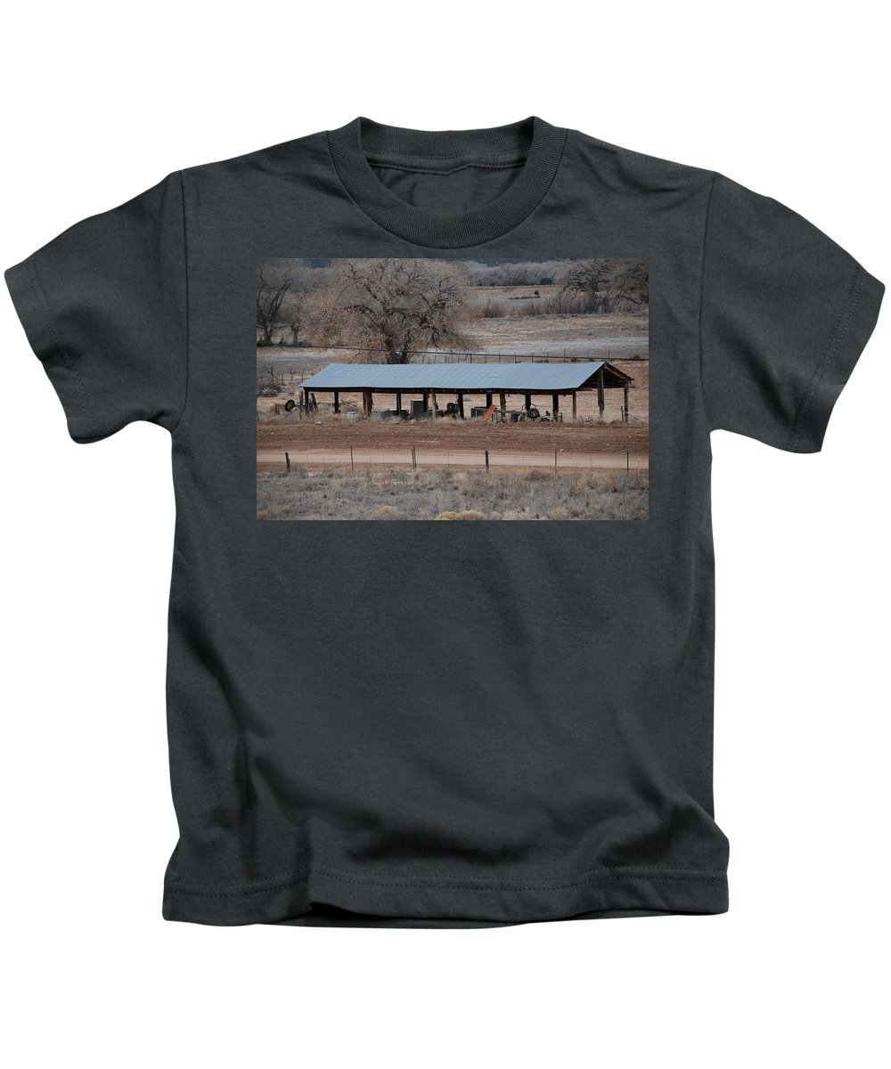 Architecture Kids T-Shirt featuring the photograph Tractor Port On The Ranch by Rob Hans