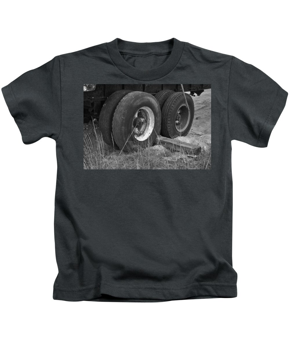 Black And White Kids T-Shirt featuring the photograph Truck Tires by Rob Hans