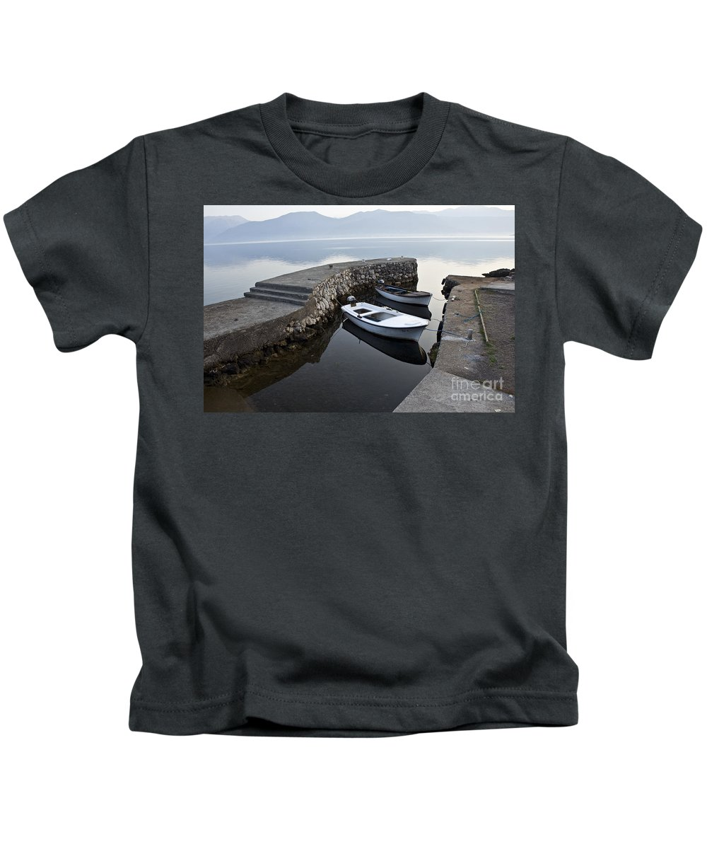 Atmosphere Kids T-Shirt featuring the photograph Two Wooden Boats In A Little Bay In The Morning by Dan Radi