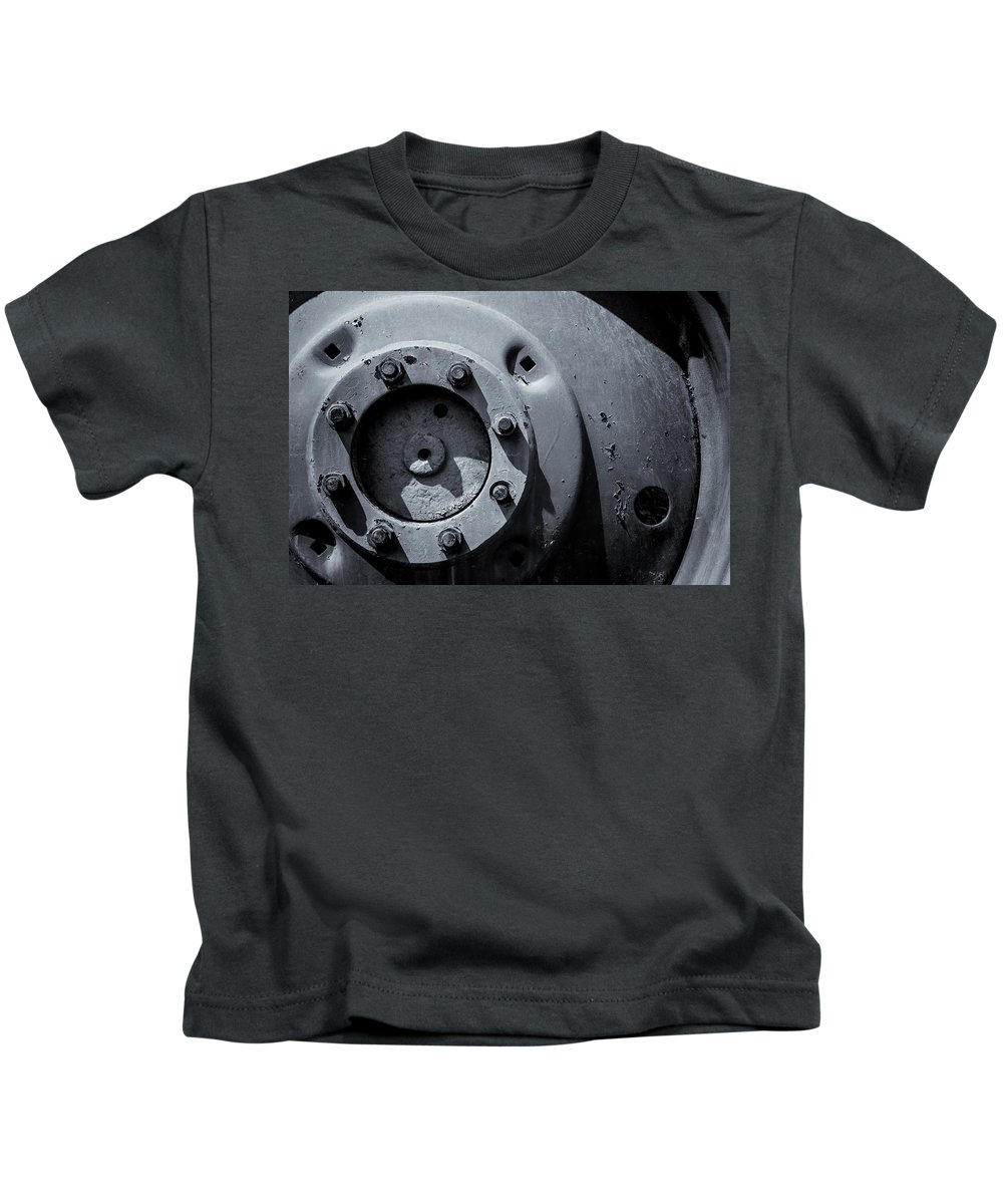 Vehicle Wheel Kids T-Shirt featuring the photograph Wheel Bolts In Metal by John Williams