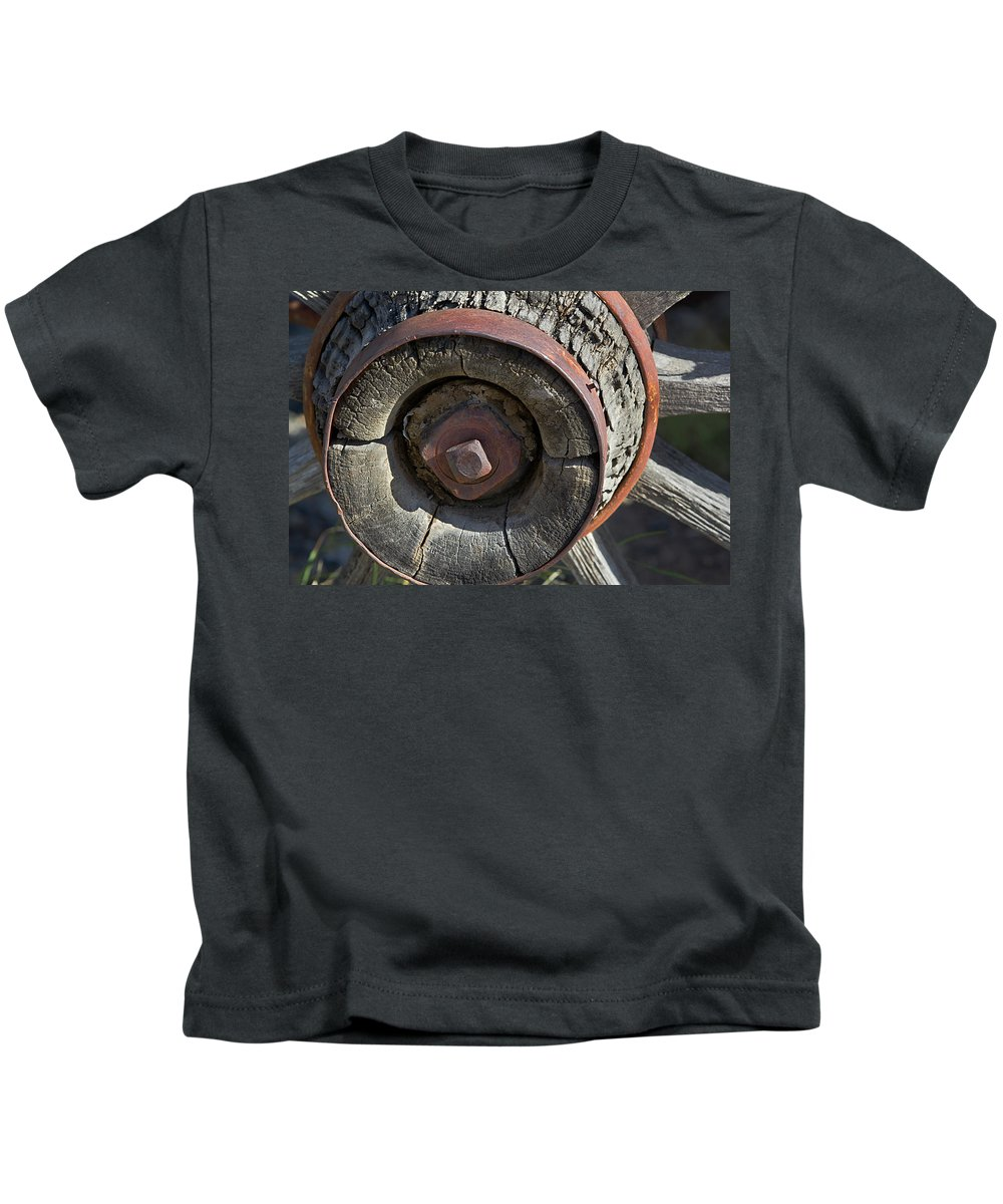 Wheel Kids T-Shirt featuring the photograph Wooden Hub by Phyllis Denton