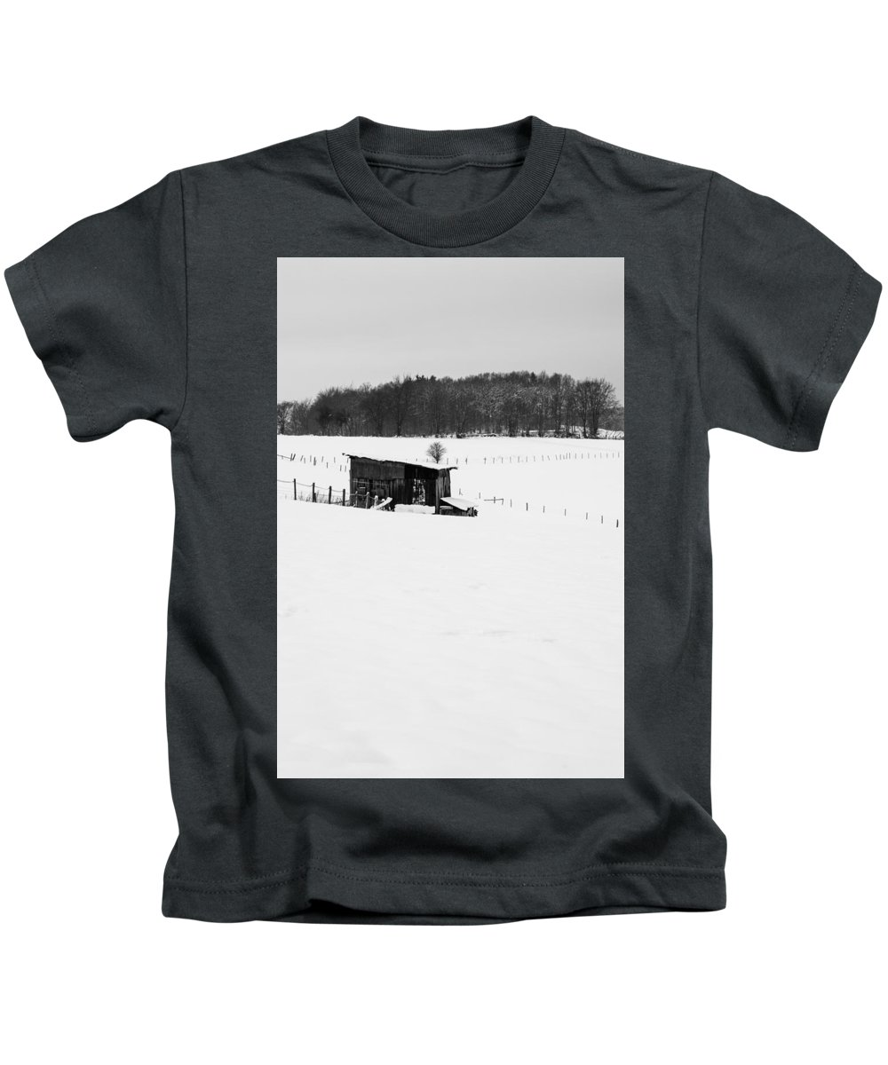 Black And White Kids T-Shirt featuring the photograph Wooden Stable In Winter Landscape by Pati Photography