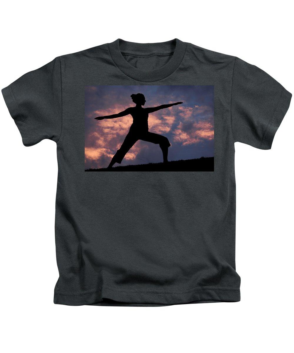 Yoga Kids T-Shirt featuring the photograph Yoga Sunset by Karen Ulvestad