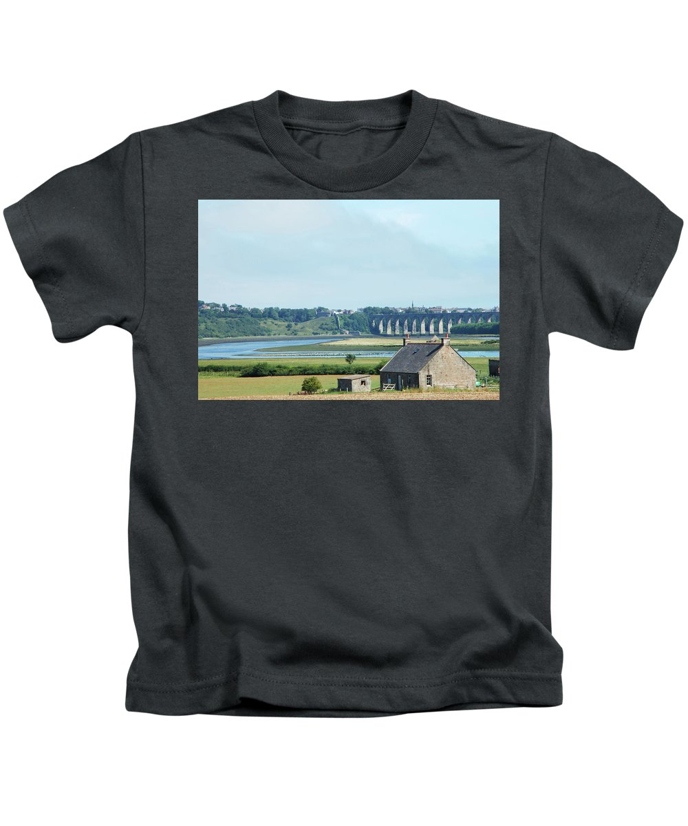 Cottage Kids T-Shirt featuring the photograph river and bridge towards Berwick upon Tweed scotland by Victor Lord Denovan