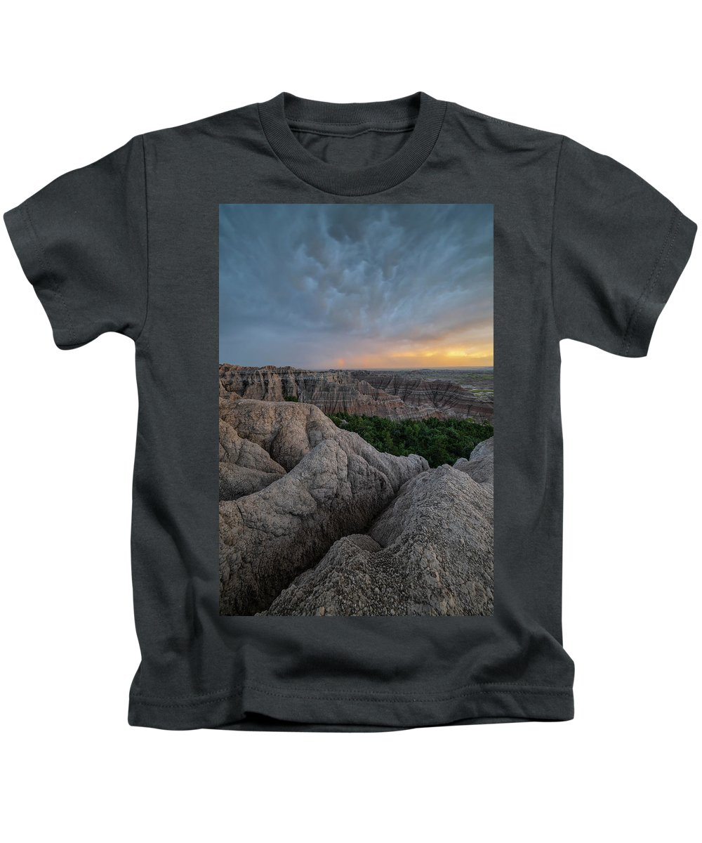 North America Kids T-Shirt featuring the photograph Thunder Over The Badlands by Christian Heeb