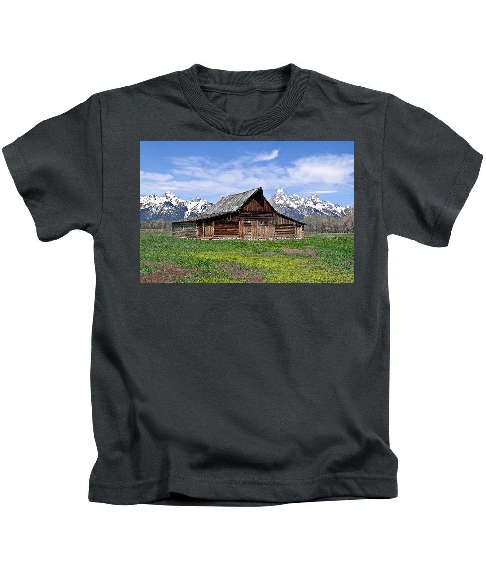 Teton Kids T-Shirt featuring the photograph Mormon Barn Tetons by Douglas Barnett