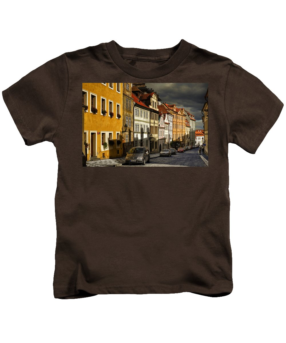 Cities Kids T-Shirt featuring the photograph Sunshine In The Midst Of Storms by Joan Carroll