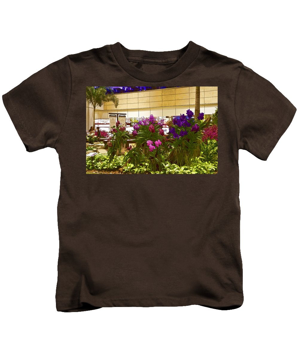 Airport Kids T-Shirt featuring the photograph Beautiful Flowers Inside The Changi Airport In Singapore by Ashish Agarwal