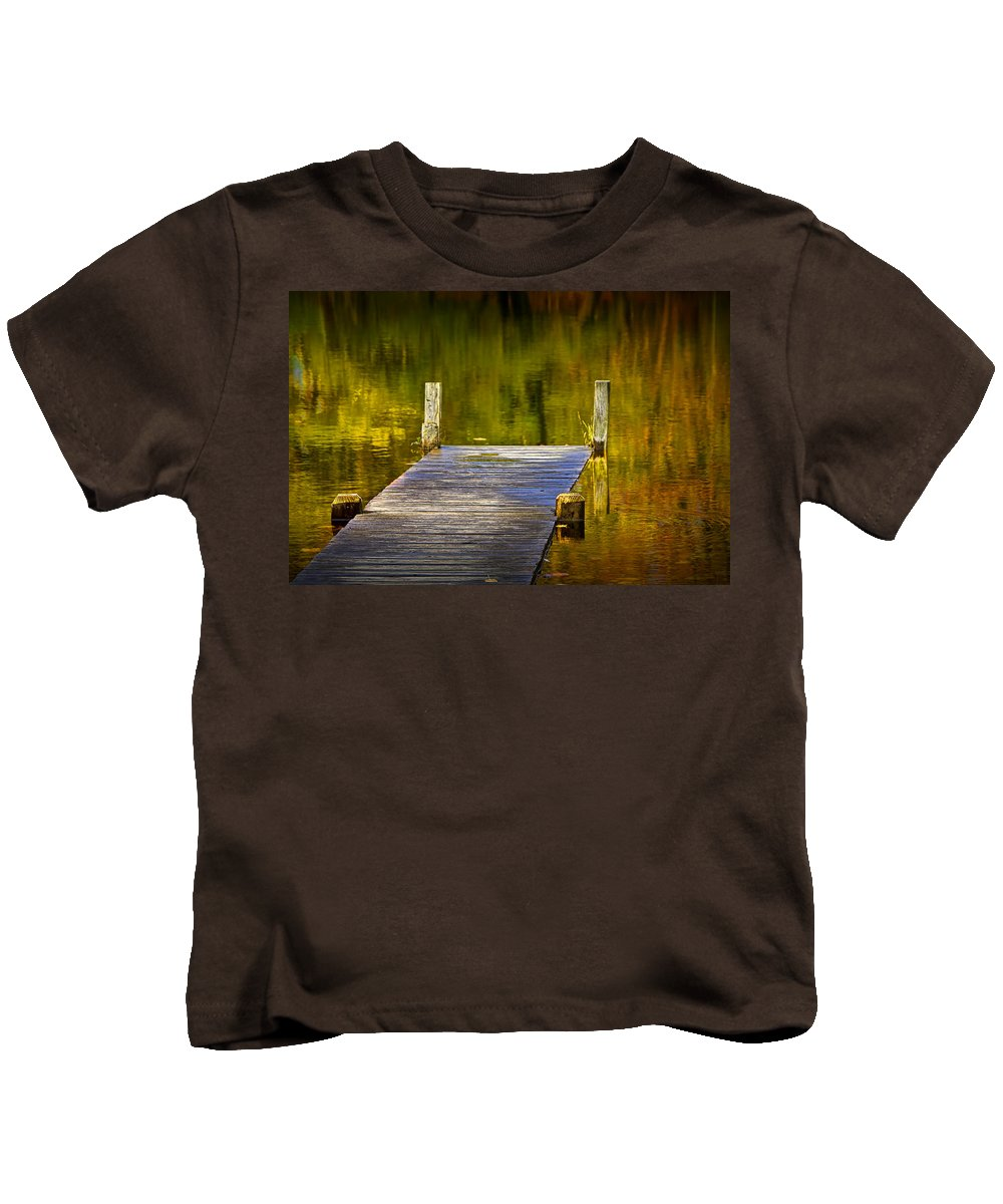 Art Kids T-Shirt featuring the photograph Autumn Reflections And Boat Dock On A Pond Near Yankee Springs Michigan by Randall Nyhof