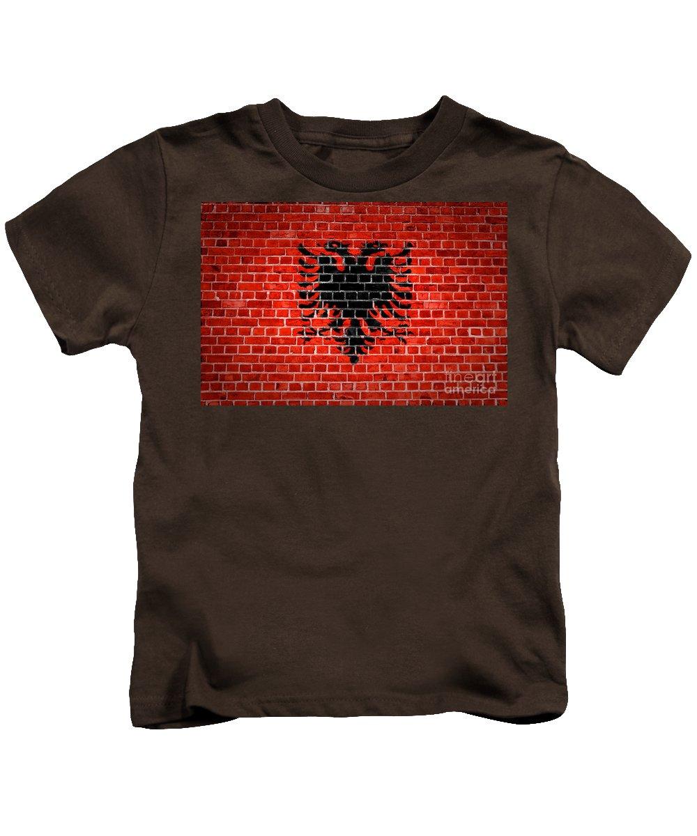 Albania Kids T-Shirt featuring the digital art Brick Wall Albania by Antony McAulay