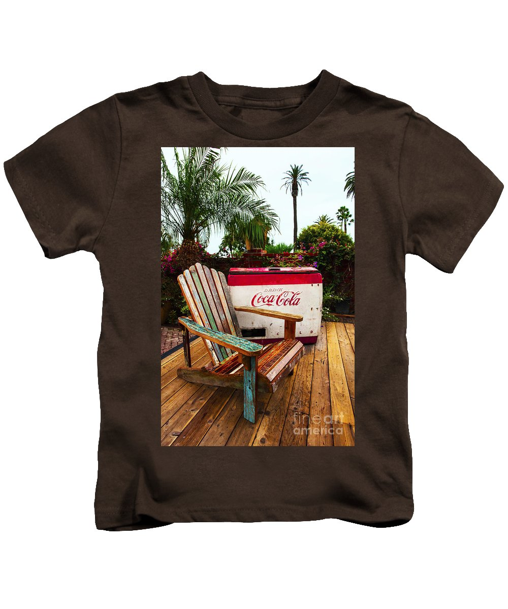 Coke Machine Adirondack Chair Kids T-Shirt featuring the photograph Vintage Coke Machine With Adirondack Chair by Jerry Cowart