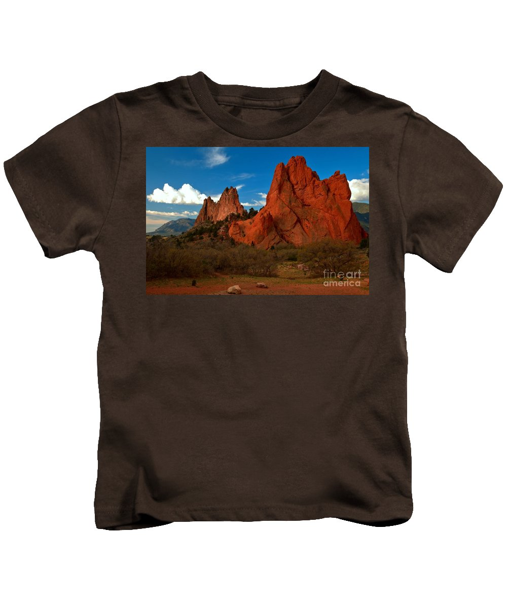 Sunrise At Garden Of The Gods Kids T-Shirt featuring the photograph Fluffy Clouds Over Jagged Peaks by Adam Jewell