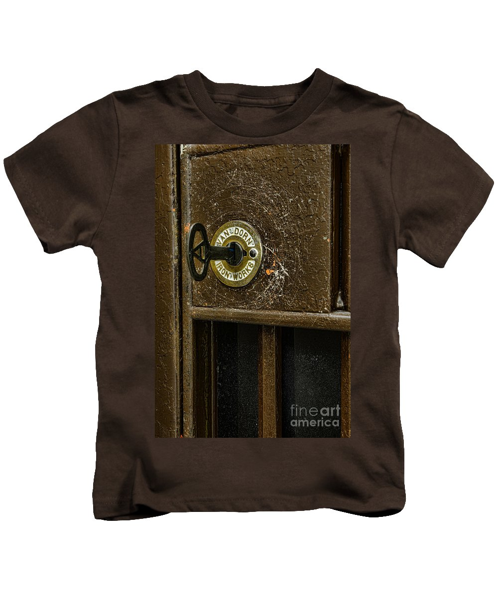 Paul Ward Kids T-Shirt featuring the photograph Jail Cell Door Lock And Key Close Up by Paul Ward