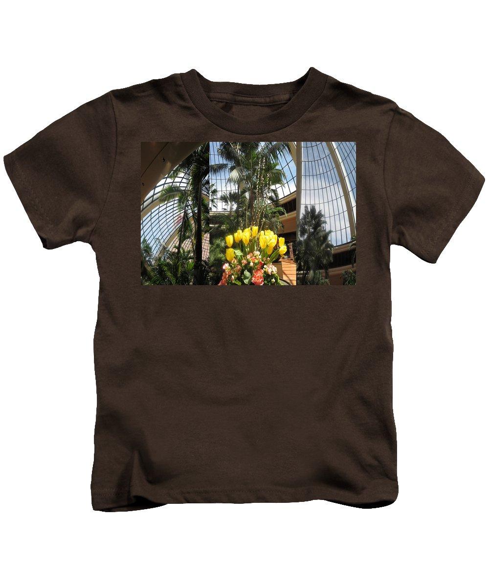 Las Vegas Kids T-Shirt featuring the mixed media Las Vegas Attrium Architecture N Interior Decorations Casinos Resorts Hotels Flowers Sky Green Signa by Navin Joshi