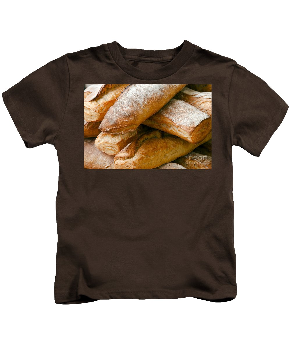 Market Day Lourmarin Markets France French Bread Loaf Loaves Still Life Provence Kids T-Shirt featuring the photograph Loaves by Bob Phillips