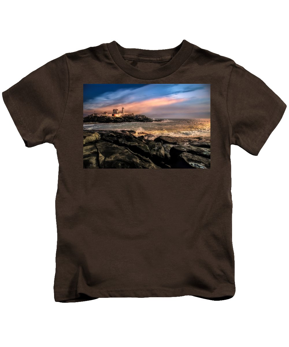 Nubble Kids T-Shirt featuring the photograph Nubble Lighthouse Winter Solstice Sunset by Bob Orsillo