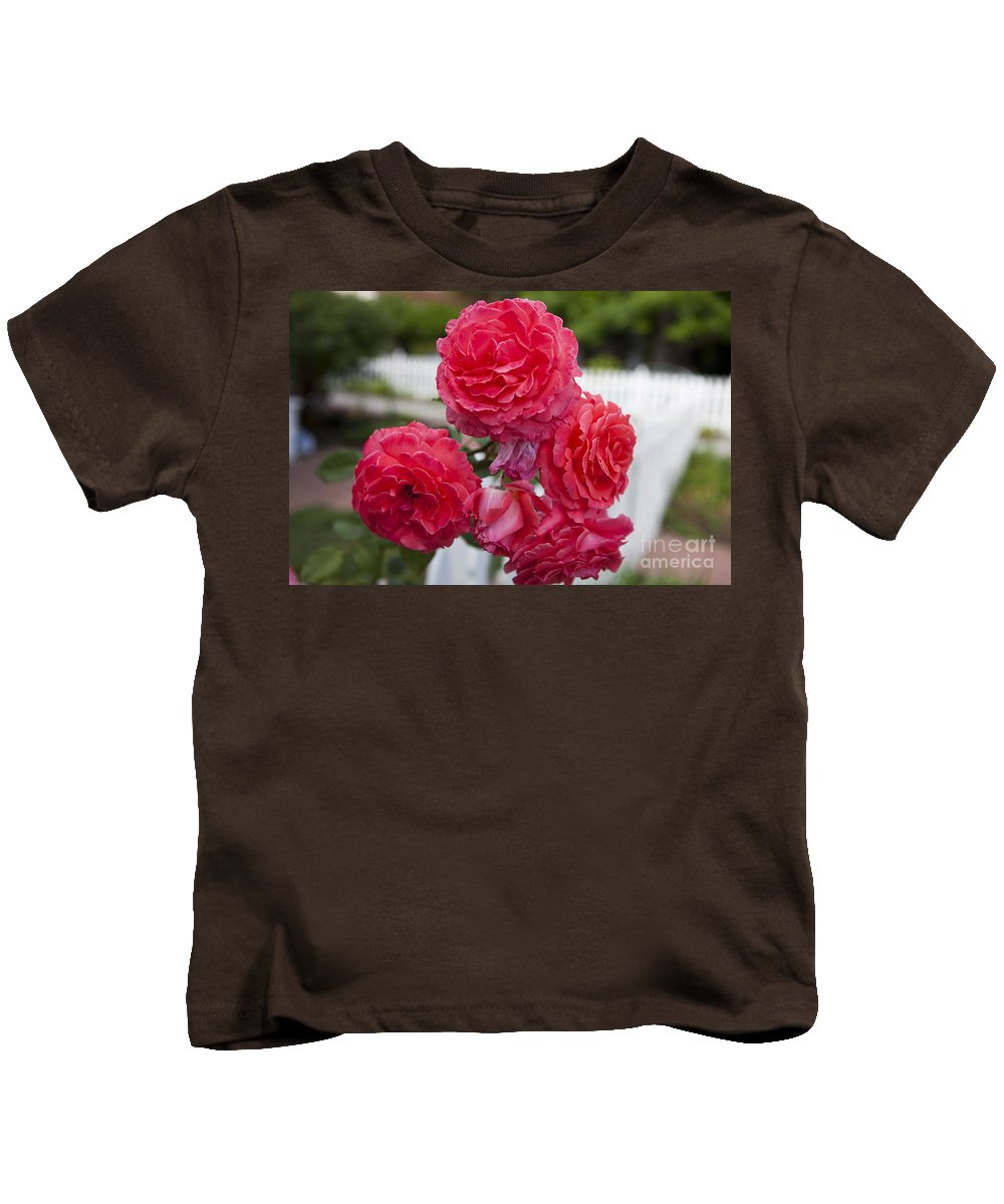 Pink Kids T-Shirt featuring the photograph Pink Roses White Picket Fence by Jason O Watson