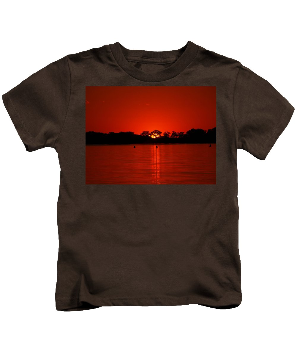 Peterson James Nature Sunset Sunsets Seascapes Seascape Landscape Landscapes Blood Cherry Ruby Scarlet Magenta Red Crimson Wine Colored Orange Reflection Reflections Minnesota Lakes Home Dr Cabin Vacation Sun Silhouette Silhouettes Lake Charlotte Water Waterscape Waterscapes Sky Skies Sailor's Delight Sailor Sailors Nautical Evening Horizon Sunshine Sunlight Weather Dramatic Scenic Peaceful Majestic Ablaze Blazing Blaze Fire Vibrant Vivid Brilliant Romantic Glowing Sold Aglow Glowing Kids T-Shirt featuring the photograph Red by James Peterson