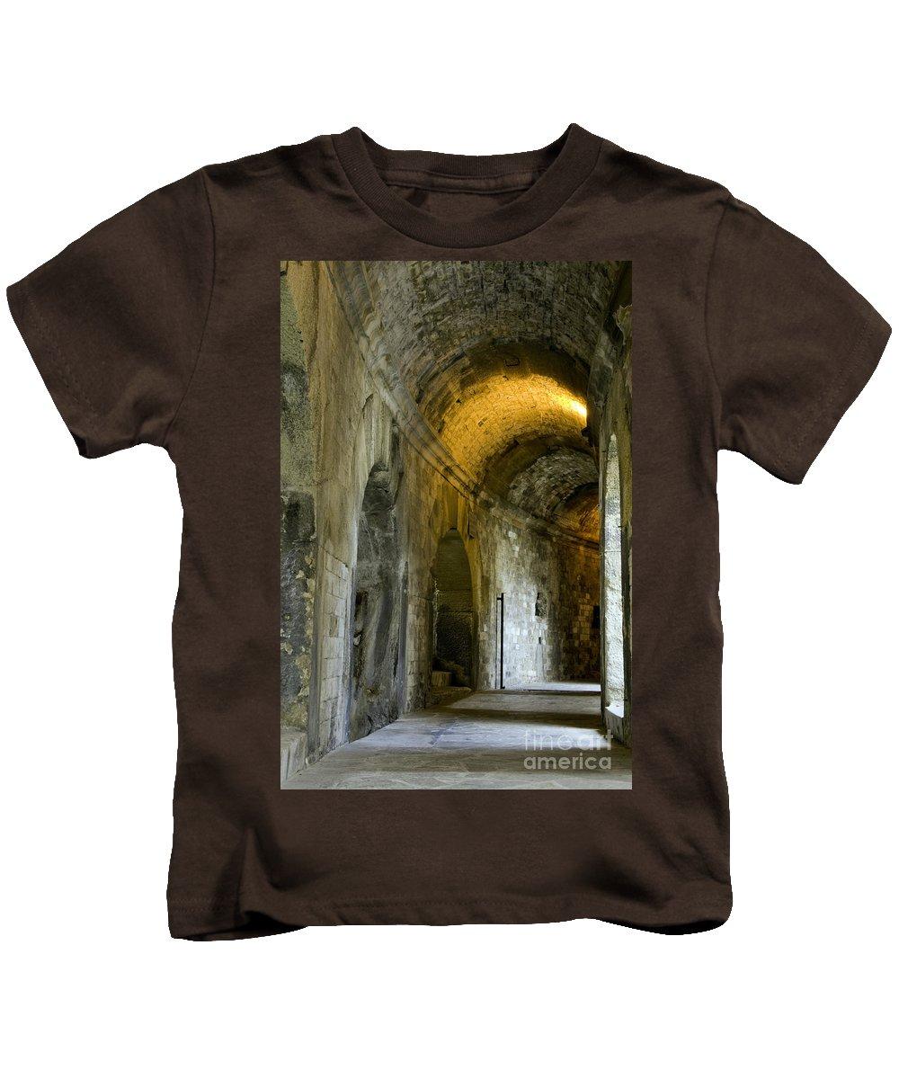 Nîmes Arena France Arenas Stone Stones Corridor Corridors Passageway Passageways Ruin Ruins Architecture Kids T-Shirt featuring the photograph Roman Arena by Bob Phillips