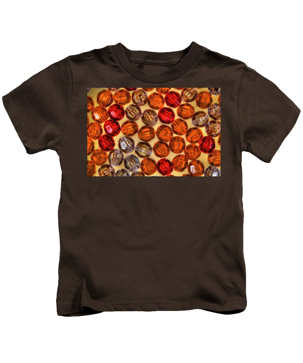 Macro Photography Kids T-Shirt featuring the photograph Spheres Of Beads by Richard J Cassato