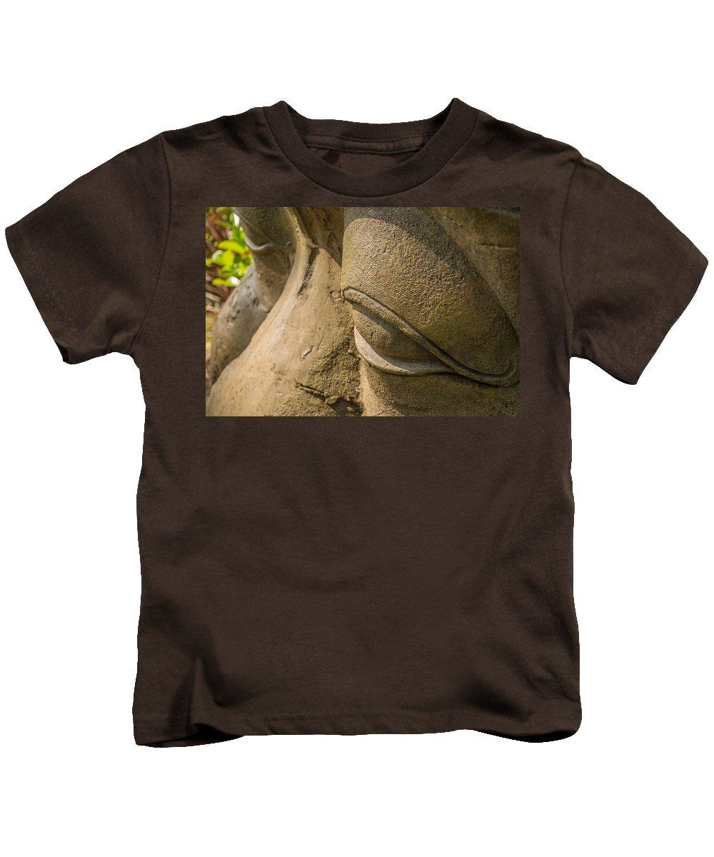 Buddha Kids T-Shirt featuring the photograph Stone Idol by Mair Hunt