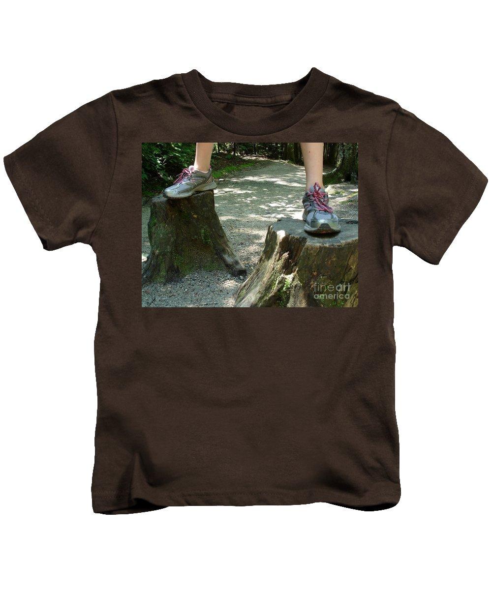 Tree Kids T-Shirt featuring the photograph Tree Stump Stilts by Kerri Mortenson