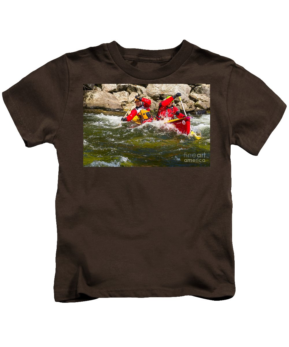 Canoe Kids T-Shirt featuring the photograph Two Men Paddling A Red Whitewater Canoe by Les Palenik