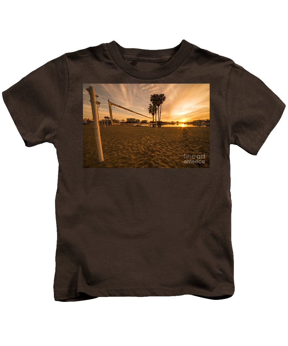 Kids T-Shirt featuring the photograph Volley Sunrise by Rob Hawkins
