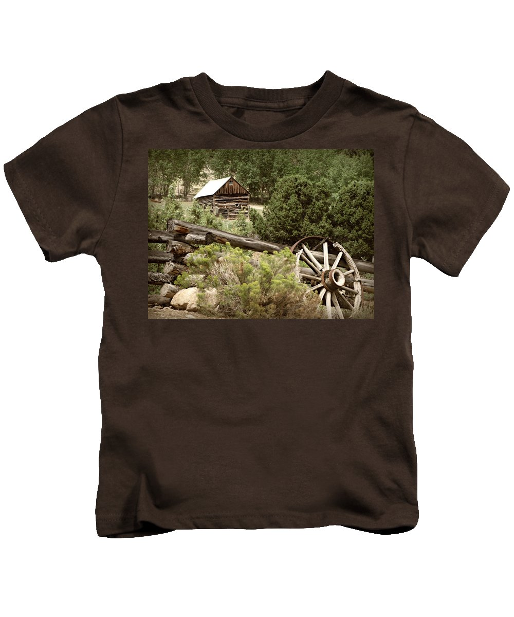 Cabin Kids T-Shirt featuring the photograph Wagon Wheel by Katie Wing Vigil