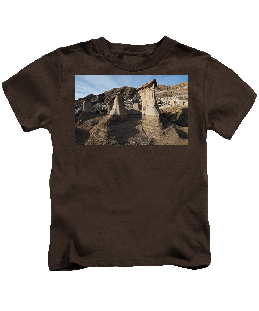 Hoodoos Kids T-Shirt featuring the photograph Badland Hoodoos Alberta by David Kleinsasser