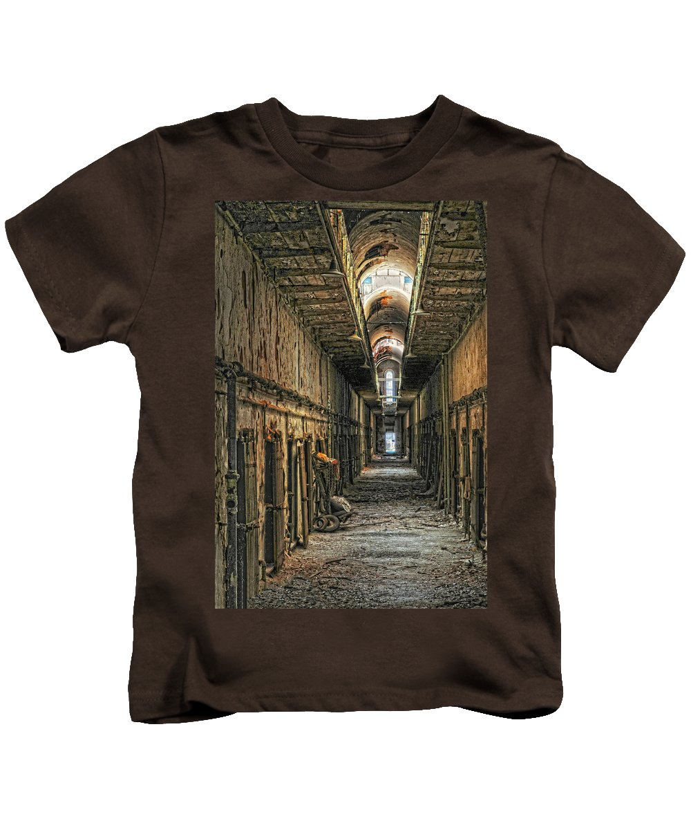Eastern State Penitentiary.jail Kids T-Shirt featuring the photograph Hallway Eastern State Penitentiary by Dave Mills