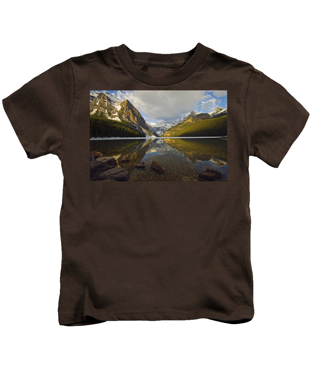 Calming Kids T-Shirt featuring the photograph Mountains Reflected In Lake Louise by Mike Grandmailson