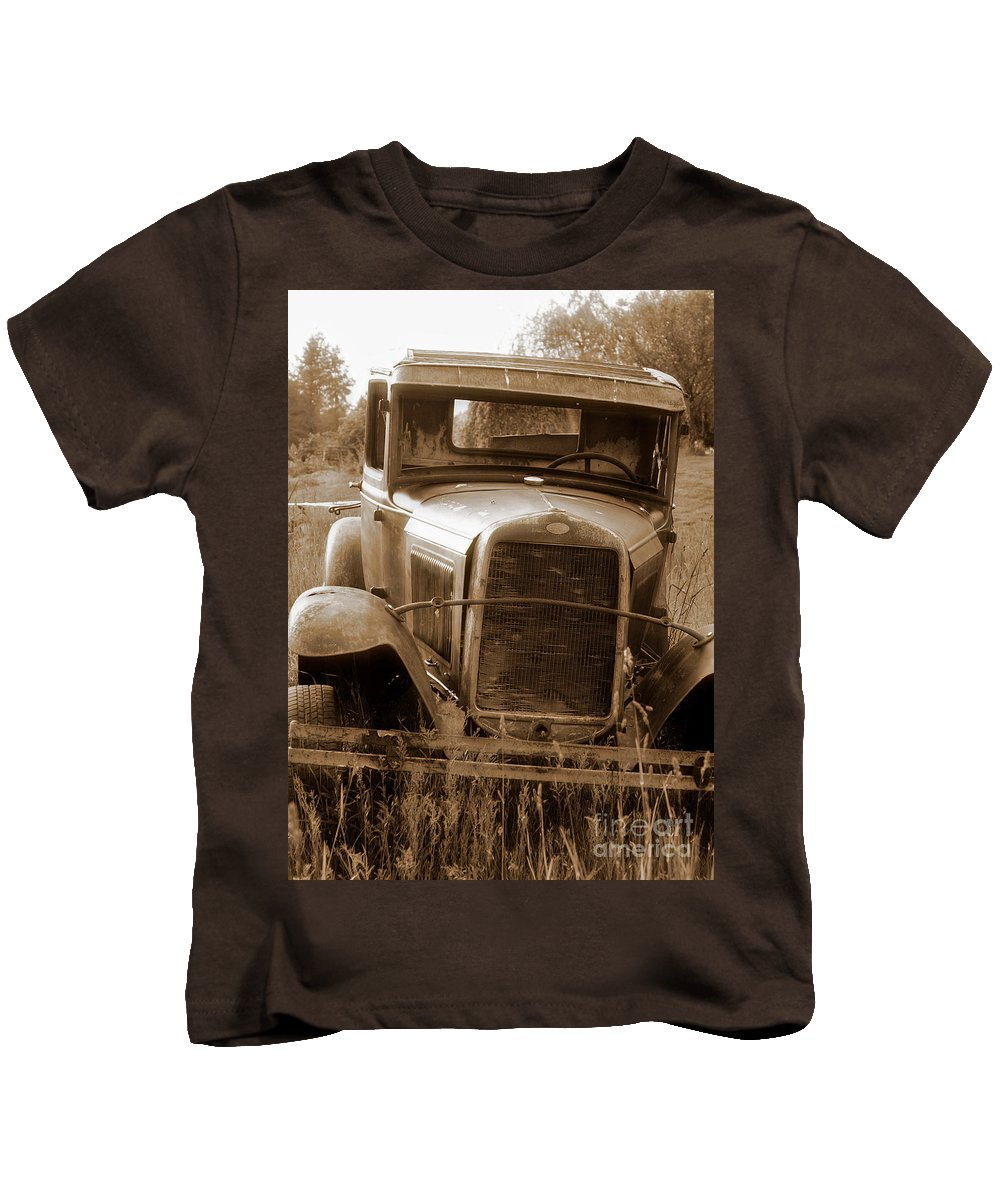 Cars Kids T-Shirt featuring the photograph Old Rustic Ford-sepia by Randy Harris