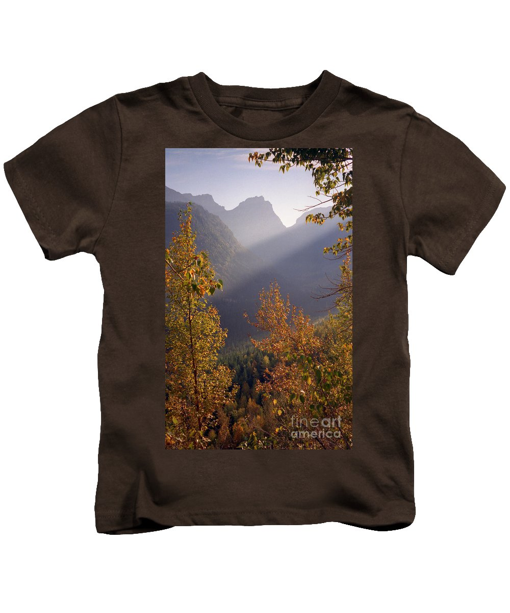 Mountains Kids T-Shirt featuring the photograph Autumn At Logan Pass by Richard Rizzo