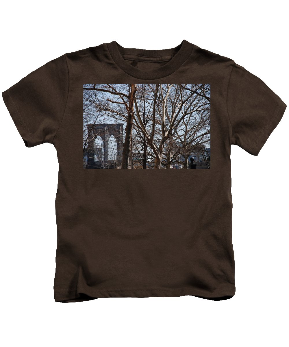 Architecture Kids T-Shirt featuring the photograph Brooklyn Bridge Thru The Trees by Rob Hans
