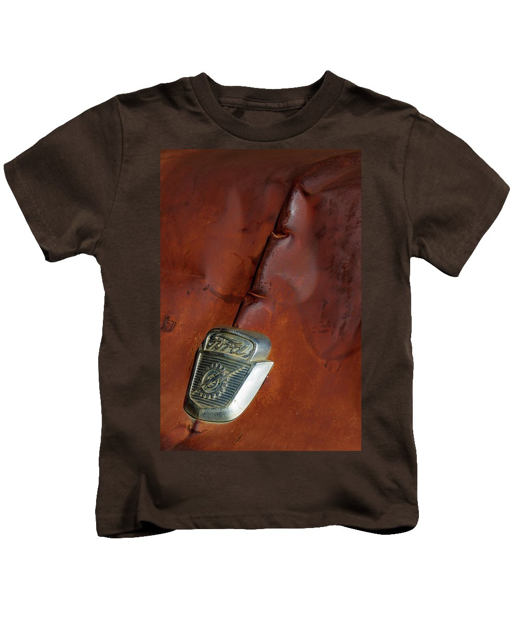 Castle Dome City Kids T-Shirt featuring the photograph Just A Couple A Dents In The Hood by Guy Shultz