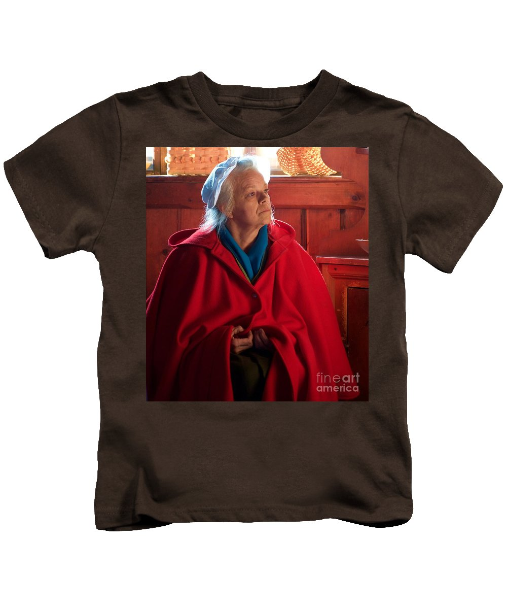 Lady In Red Cape Kids T-Shirt featuring the photograph Lady In Red by John Taylor