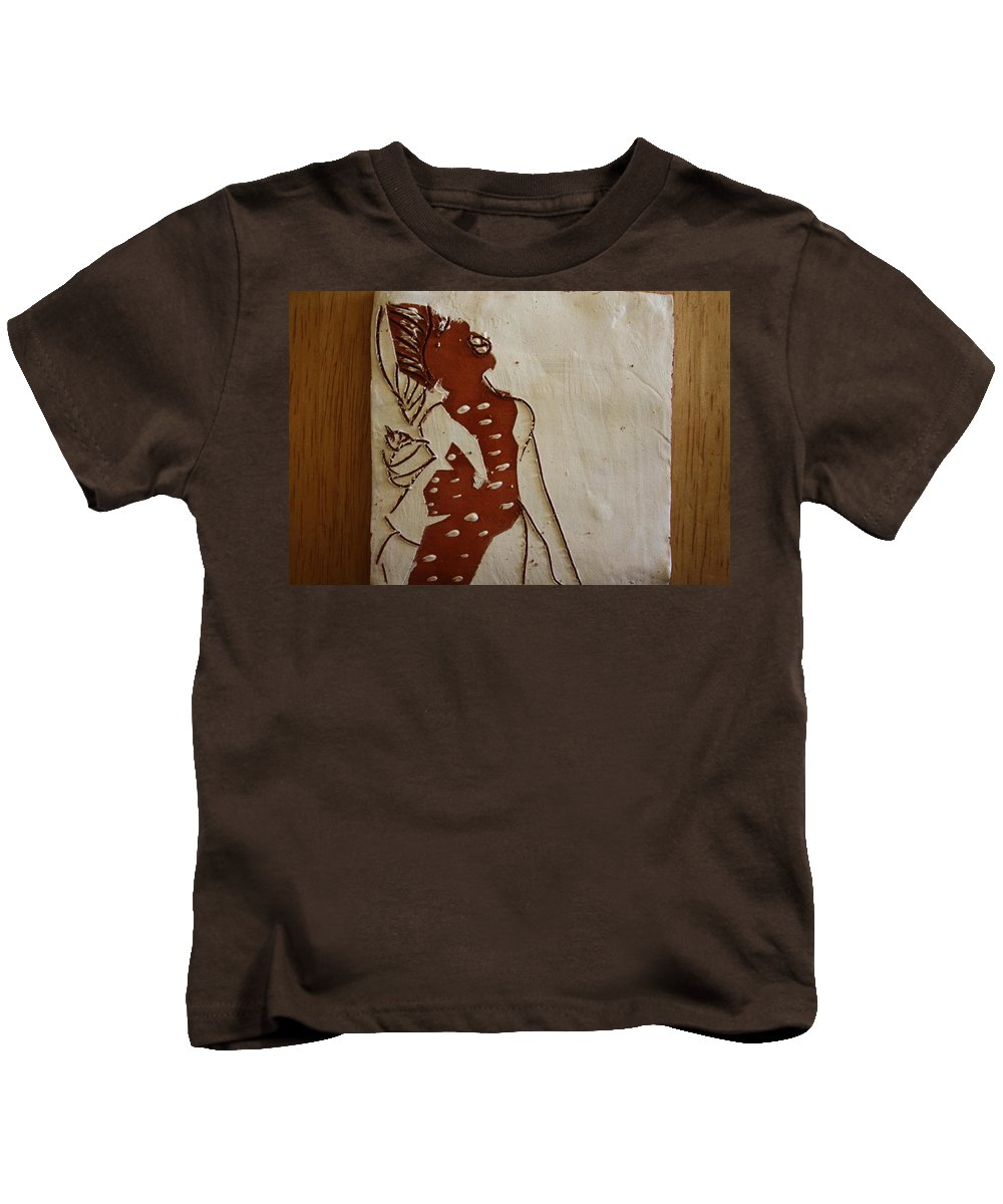 Jesus Kids T-Shirt featuring the ceramic art Mums Parcel - Tile by Gloria Ssali