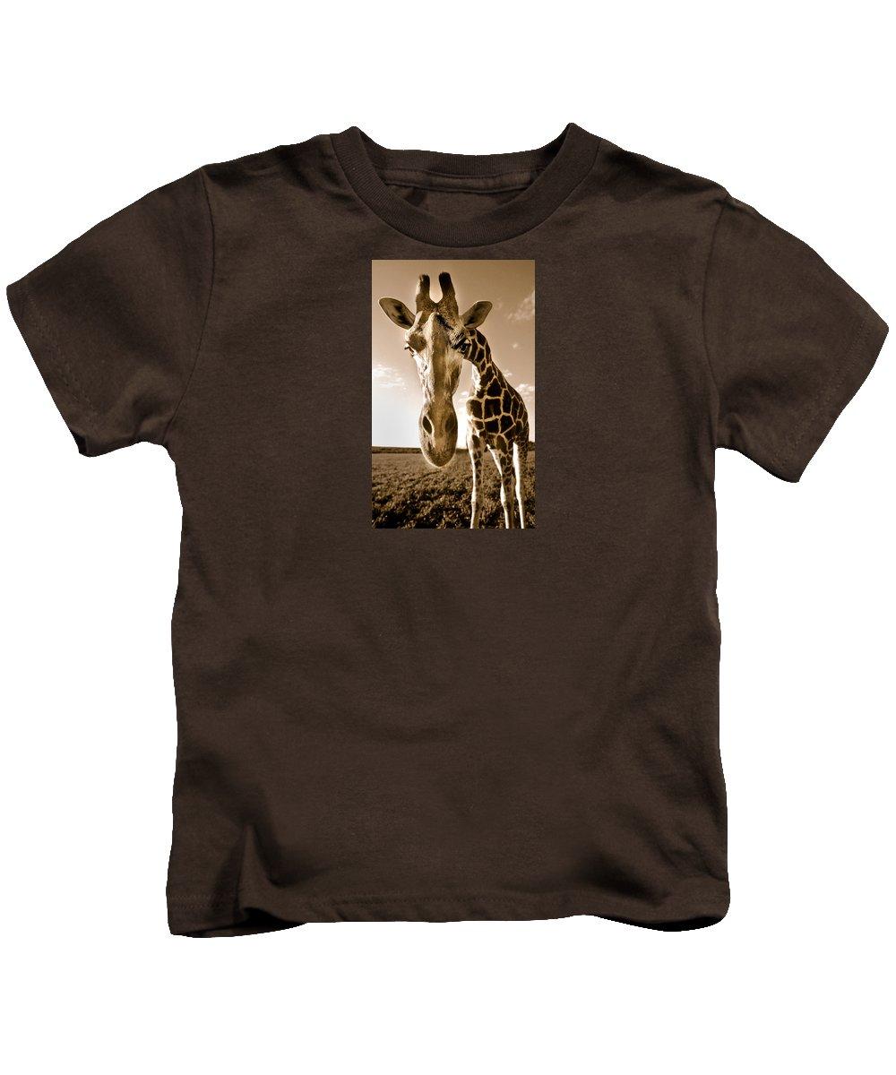 Giraffe Kids T-Shirt featuring the photograph Nosey Giraffe by Frederica Georgia
