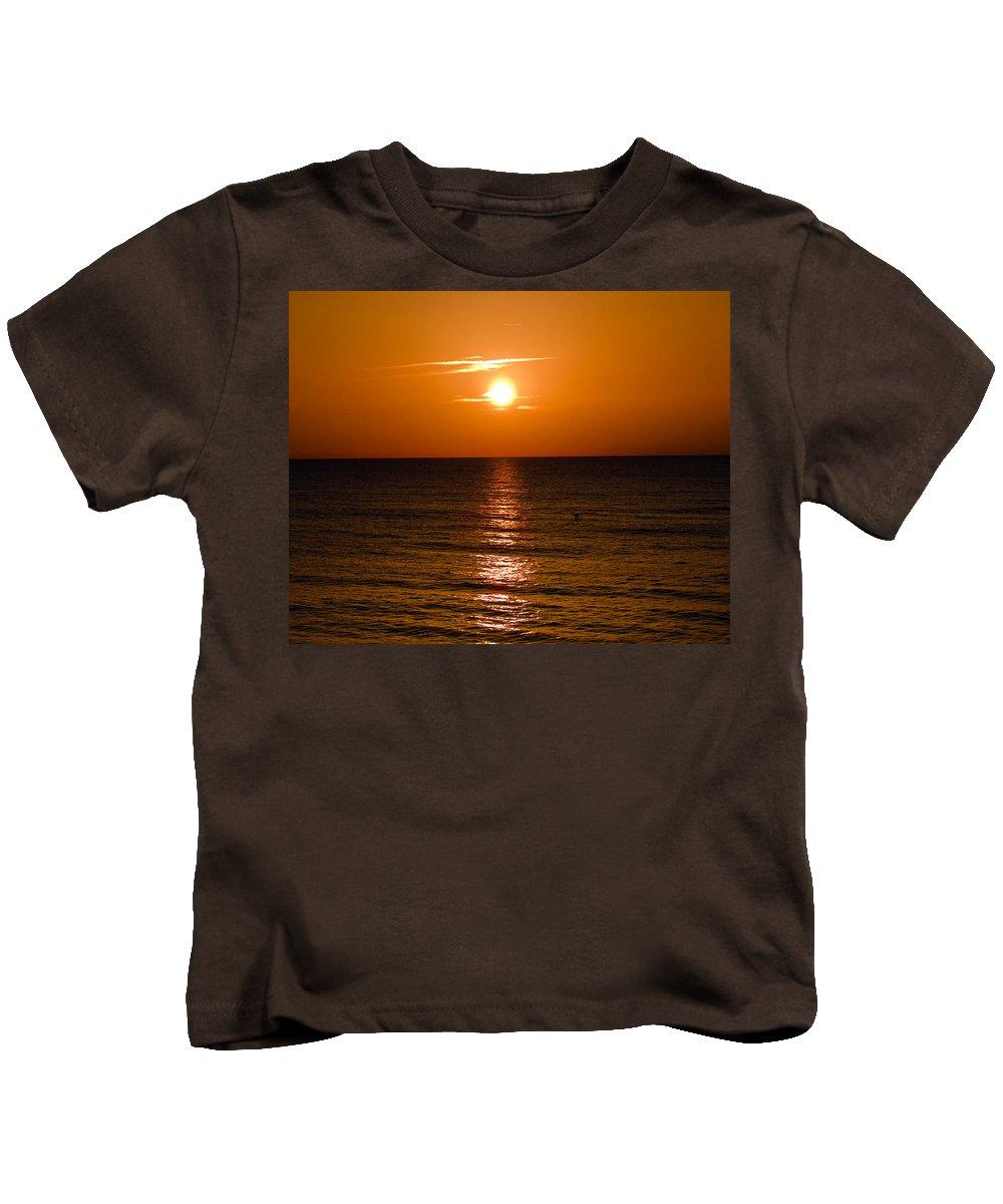 Sun; Rise; Sunrise; Orange; Florida; Morning; Solar; Ocean; Sea; Shore. Coast; Beach; Calm; Waves; S Kids T-Shirt featuring the photograph Orange Sunrise Over A Florida Beach by Allan Hughes