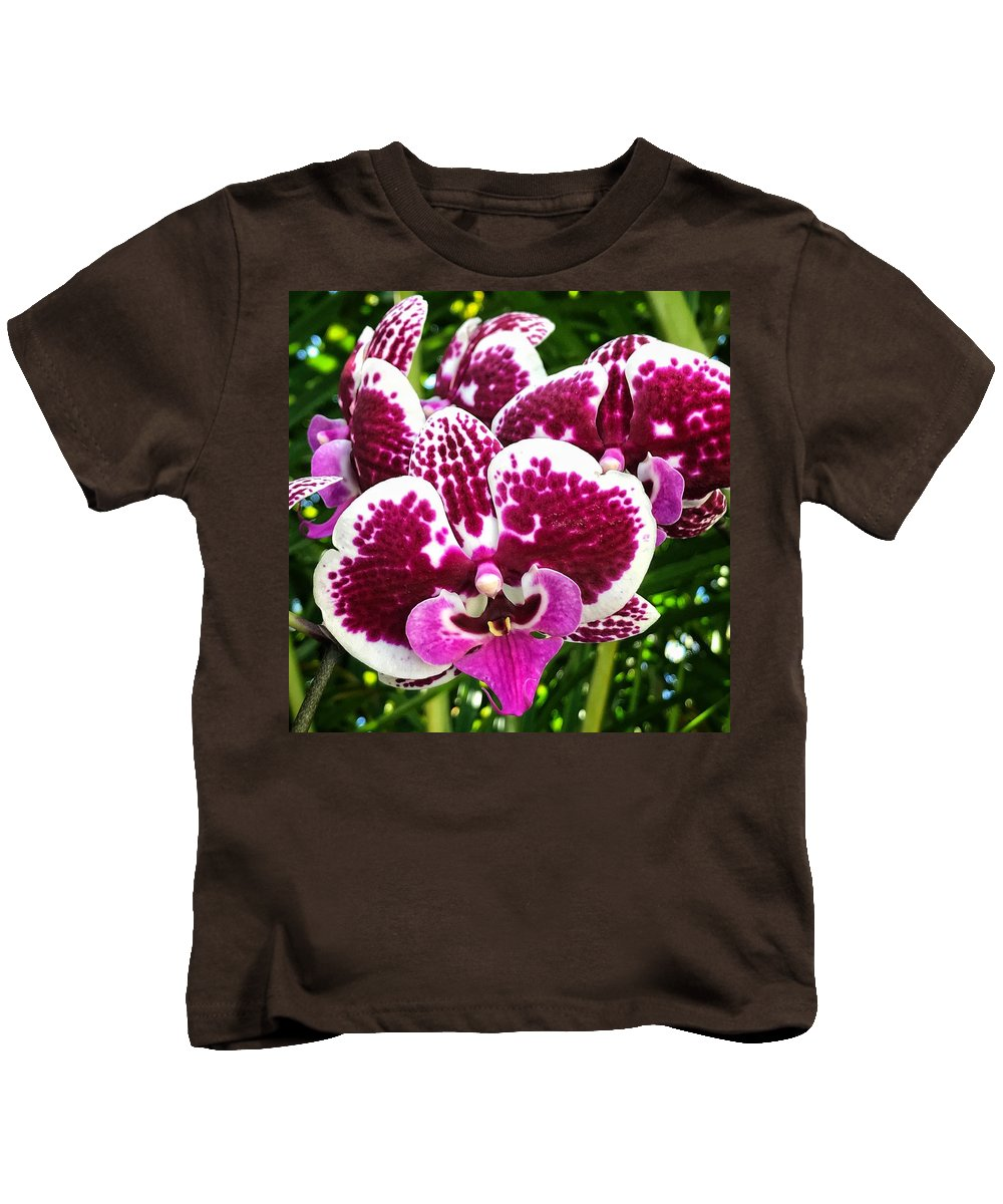 Kids T-Shirt featuring the photograph Orchid Hanging In Palms by Joe LeGrand