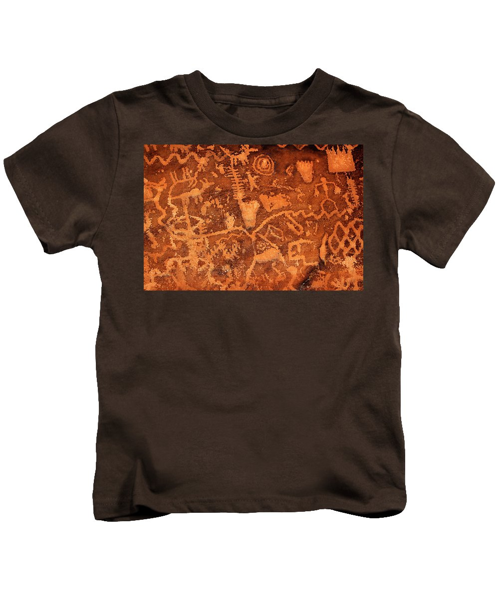 Petroglyphs Kids T-Shirt featuring the photograph Petroglyphs by Phyllis Denton