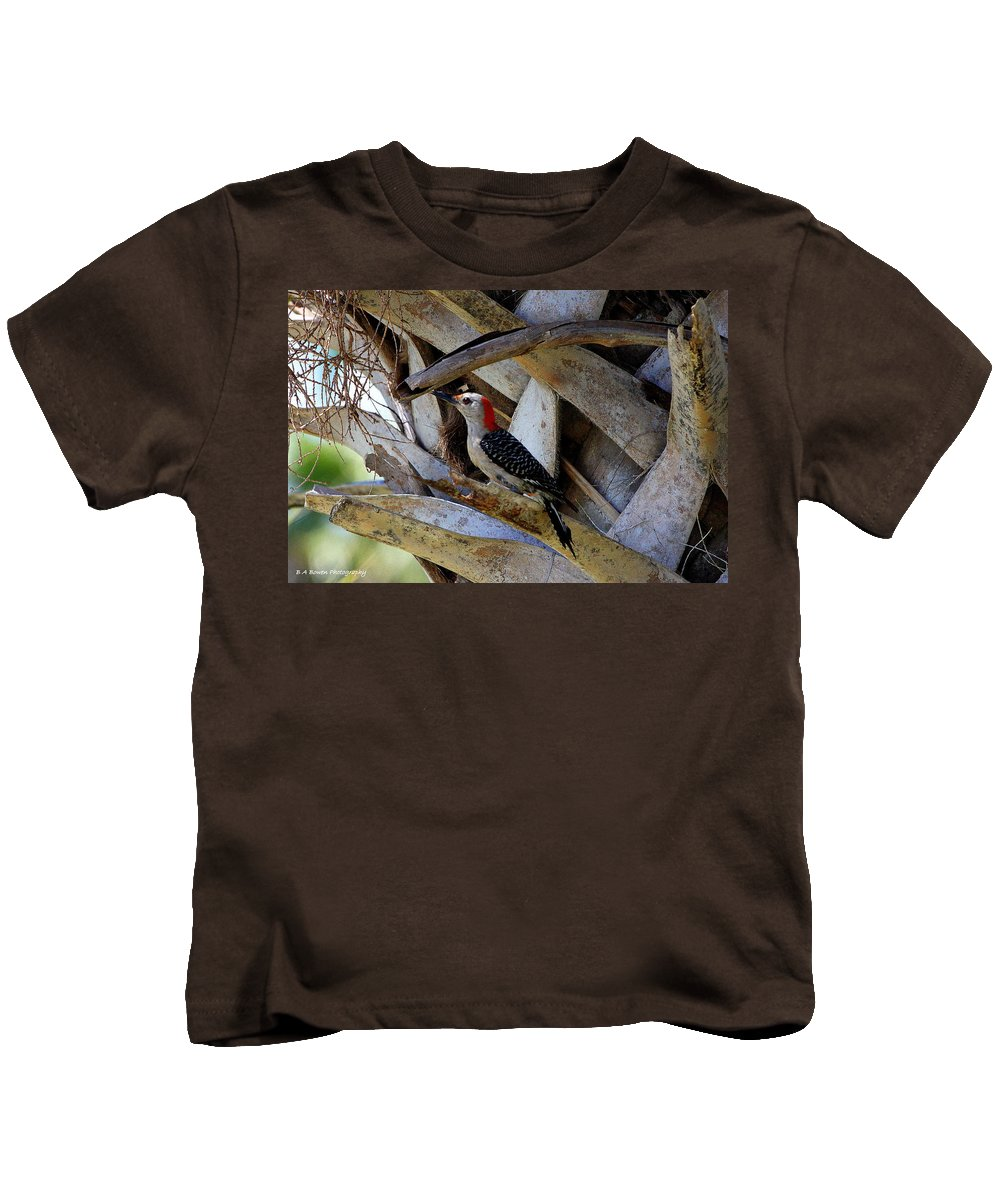 Red-bellied Woodpecker Kids T-Shirt featuring the photograph Red-bellied Woodpecker Hides On A Cabbage Palm by Barbara Bowen