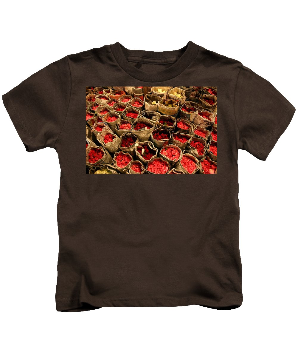 Roses Kids T-Shirt featuring the photograph Rose Rolled In Newspaper by Minaz Jantz