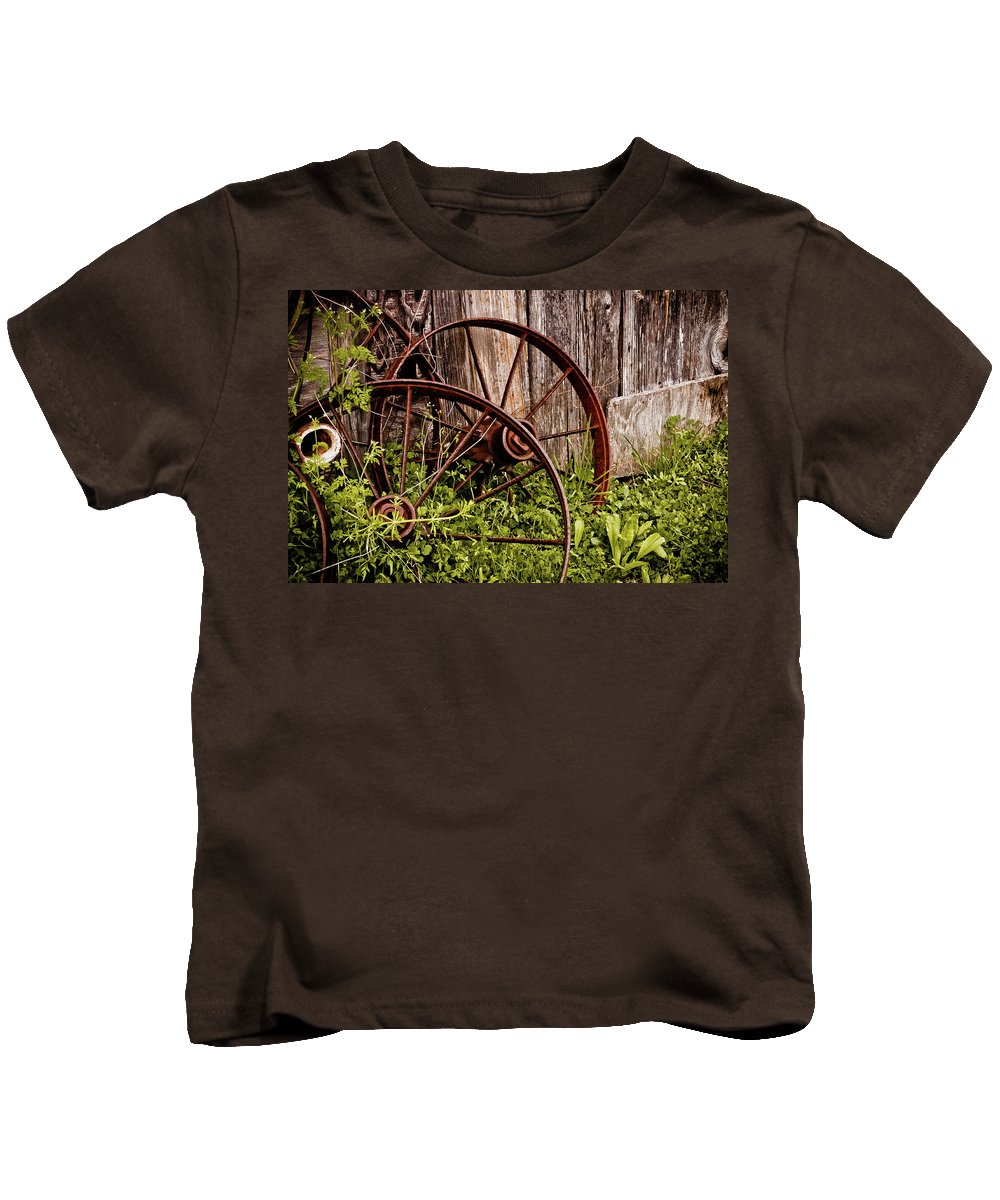 Texas Kids T-Shirt featuring the photograph Rusty Wheels by Jill Smith