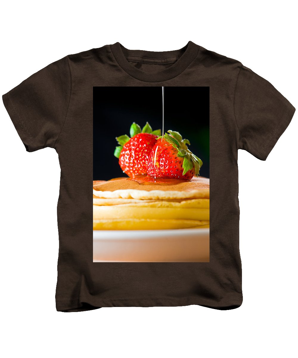 Berries Kids T-Shirt featuring the photograph Strawberry Butter Pancake With Honey Maple Sirup Flowing Down by U Schade